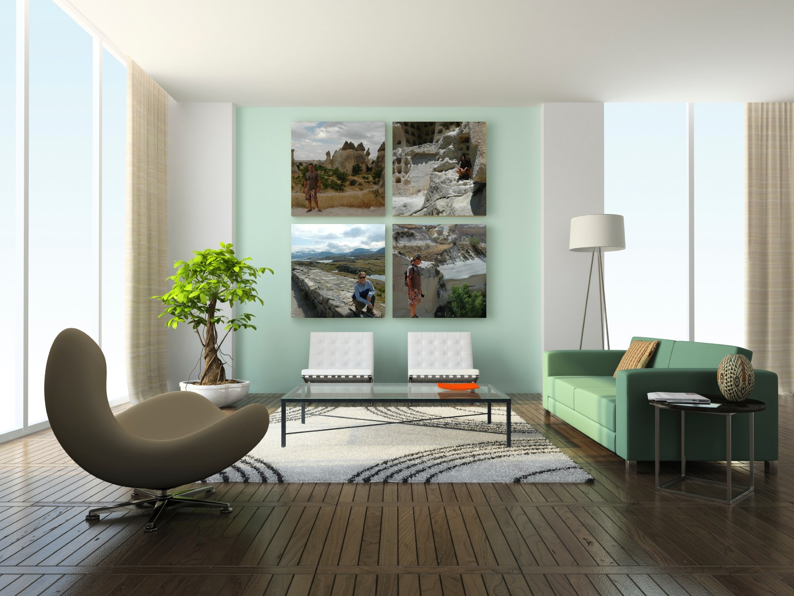 4 square canvas prints hanging on wall in home